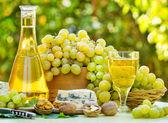 White - green grapes and white wine — Stock Photo