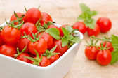 Cherry tomato in bowl on the table — Stock Photo