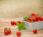 Cherry tomato in bowl — Stock Photo