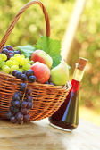 Red wine and grapes on a table — Stock Photo