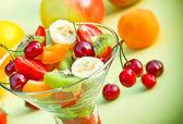 Fruit salad prepared with fresh organic fruits — Stock Photo