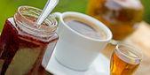 Strawberry jam, plum brandy, and coffee — Stock Photo