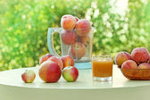Peach juice and peaches on a table — Stock Photo