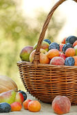 Fresh organic Fruit in  wicker basket — Stock Photo