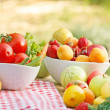 Stock Photo: Organic fruits and vegetables in bowls