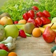 Stock Photo: Fruits and vegetables on table