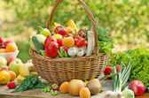 Wicker basket is full of fresh fruits and vegetables — Stock Photo
