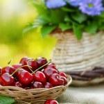 Organic cherry in wicker basket — Stock Photo #41744985