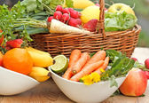 Vitamins of fresh fruits and vegetables of the spring — Stock Photo