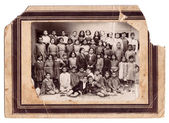 Old and damaged school photo c.1920 in old paper frame — Stock Photo