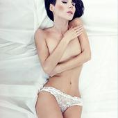Sensual girl sleeping in white bed — Stock Photo