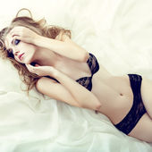 Sensual girl sleeping in white bed — Foto Stock