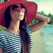 Fashion portrait of a girl on vacation — Stock Photo