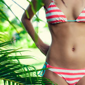 Woman's body in the tropics — Stock Photo