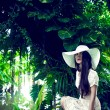 Fashion portrait of a lady in a tropical forest — 图库照片