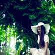 Stock Photo: Fashion portrait of lady in tropical forest