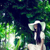 Fashion portrait of a lady in a tropical forest — Stock Photo
