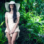 Fashion lady in the tropical jungle — Stock Photo