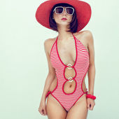 Portrait of a young girl in fashionable swimsuit — Stock Photo