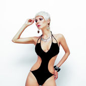 Portrait of sensual woman in fashionable swimsuit — Stock Photo
