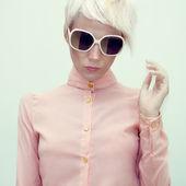 Fashion portrait of a sensual girl in glasses — Stock Photo