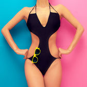 Fashion girl in a bathing suit on a pink background — Stock Photo