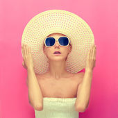 Portrait of a girl in a hat on a pink background — Stok fotoğraf