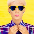 Fashion portrait of a girl in fashion sunglasses — Stock Photo #23006358