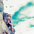 Portrait of a sensual girl on a stones background — Stock Photo