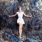 sensual girl on the rocks — Stock Photo #27540941