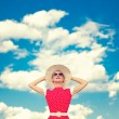 Positive retro girl on the blue sky background — Stock Photo