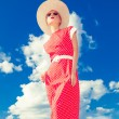 Stock Photo: Fashion retro girl on the blue sky background