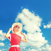 Retro girl on the blue sky background — Stock Photo
