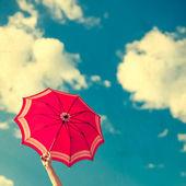 Vintage umbrella in the blue sky — Stock Photo
