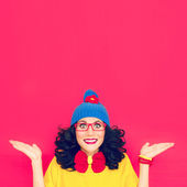 Funny portrait a girl on a crimson background — Stock Photo