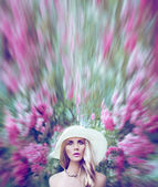 Sensual lady in a fantastic world of flowers — Stok fotoğraf