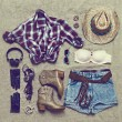 Set of clothing in cowboy retro style on old background — Stock Photo #51413417