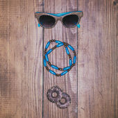 Fashion accessories on vintage wooden surface — Stock Photo