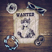 Accessories cowboy retro style on wooden background with wanted poster — Stock Photo