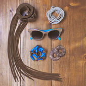 Fashion accessories on wooden background — Stock Photo