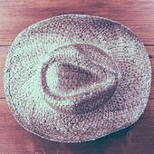 Retro cowboy hat on wooden background — Stock Photo