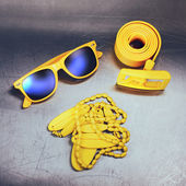 Bright yellow accessories on metal background — Foto Stock
