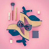 Composition of female accessories and shoes on a pink background — Stock Photo