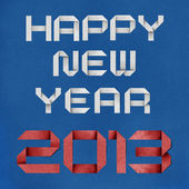 Happy new year 2013 recycled papercraft background. — Stock Photo