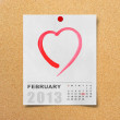 Stock Photo: Calendar 2013 and red heart on note paper.