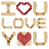 I love you alphabet and red heart recycled papercraft. — Stock Photo