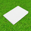 Blank notebook on Green Grass background — Stock Photo