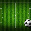 Soccer football on grass field — Stock Photo #28189301