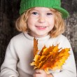 Kid with yellow maple leaves — Stock Photo #10909838