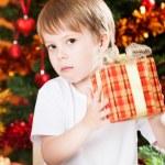 Boy holding Xmas gift — Stock Photo #11888971